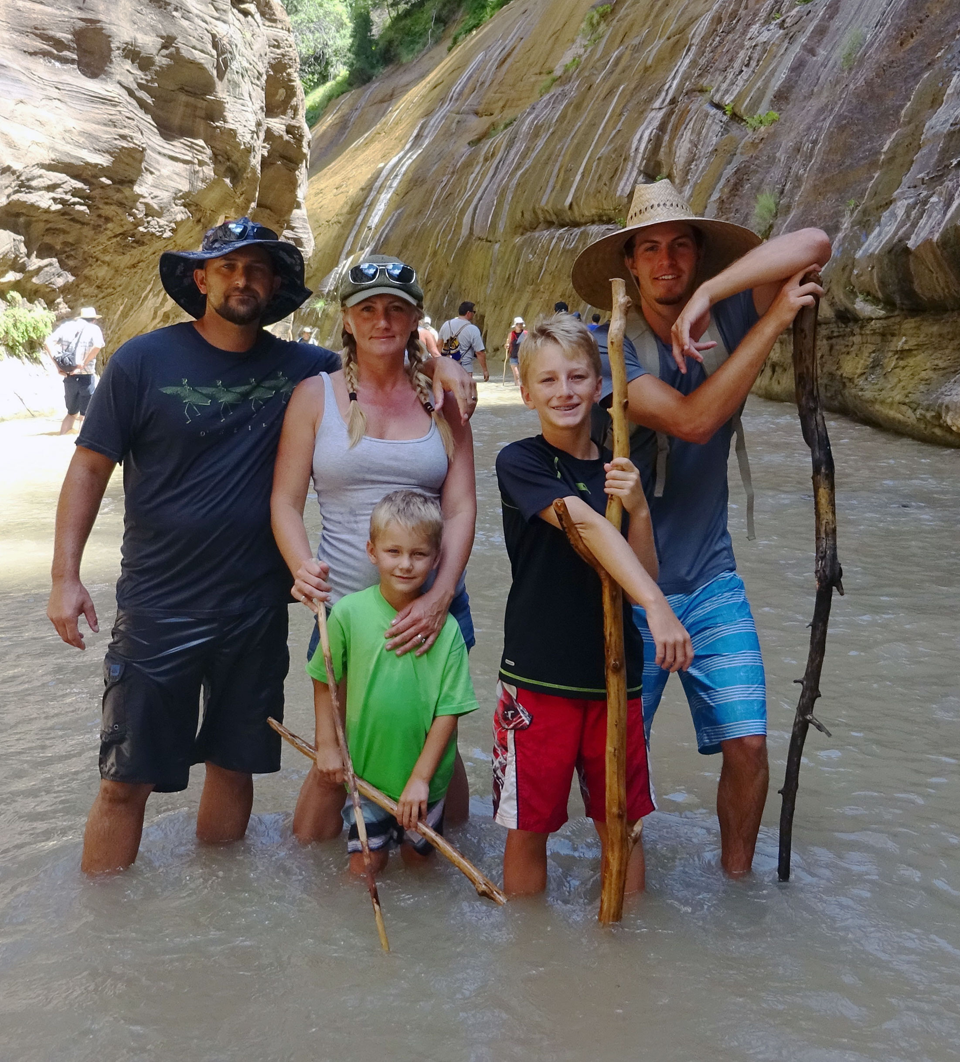 Family hiking the Narrows in Zion